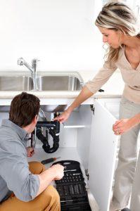 plumber-woman-garbage-disposal-repair