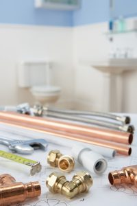 variety-of-pipes-and-plumbing-fixtures-sitting-on-table